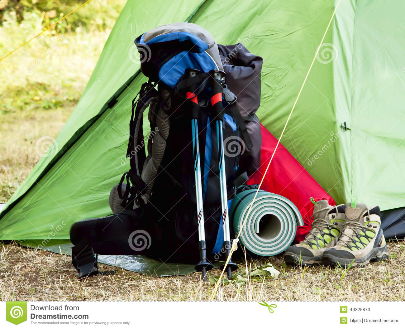 Camping Equipment With Backpack And Boots Stock Photo