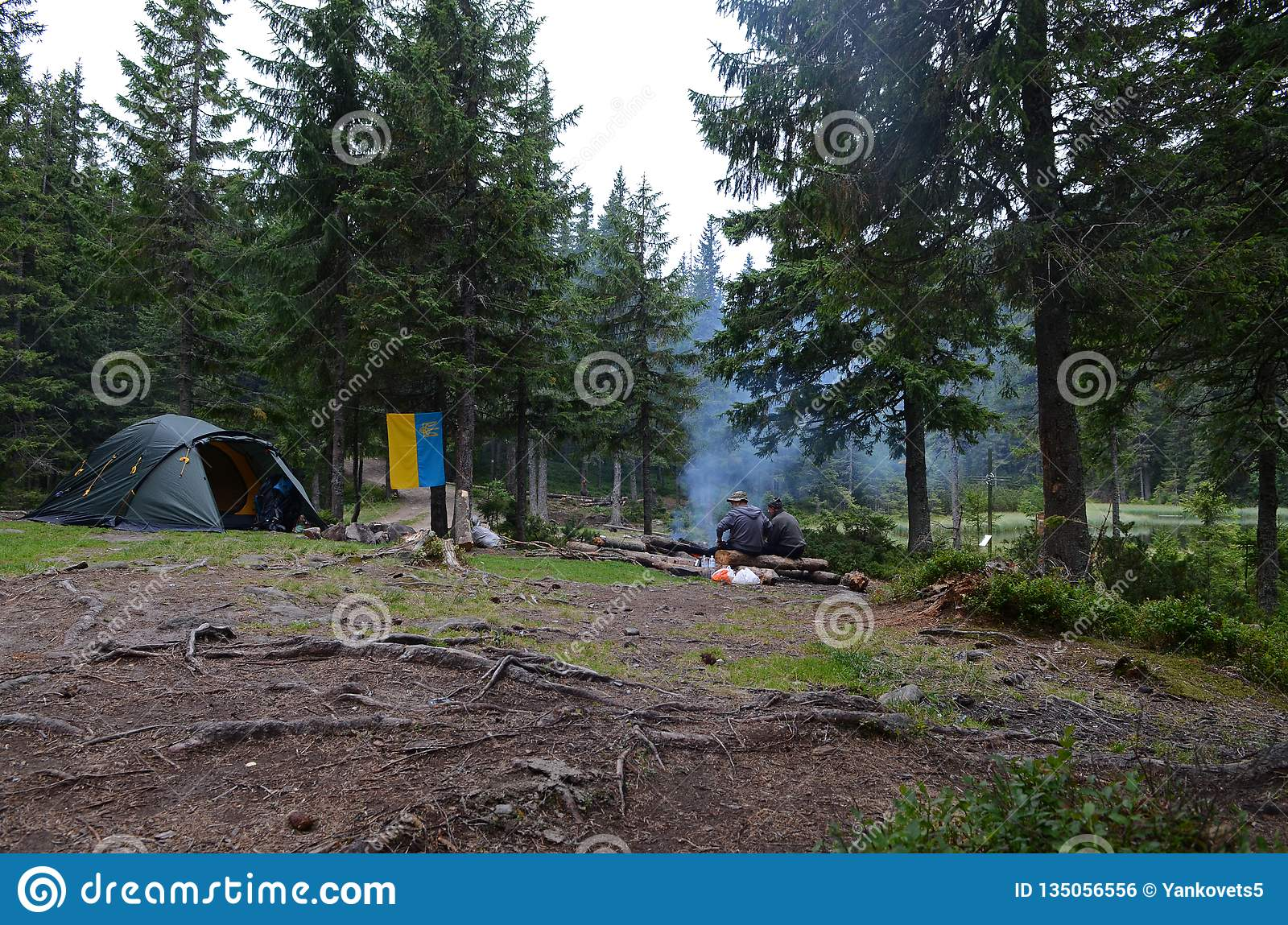 Camping in the mountains on the shore of a mountain lake