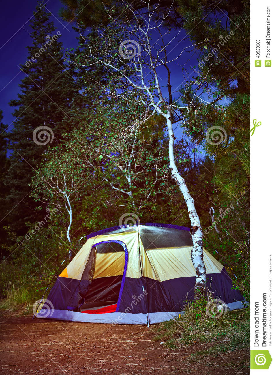 Camping Tent In The Forest At Night Stock Photo