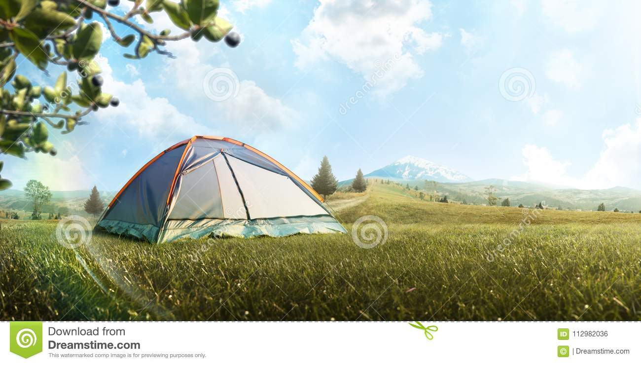 The Camping Tent in mountain in the summer. Tourism. Adventure. Travel. Hike. Background. Panorama