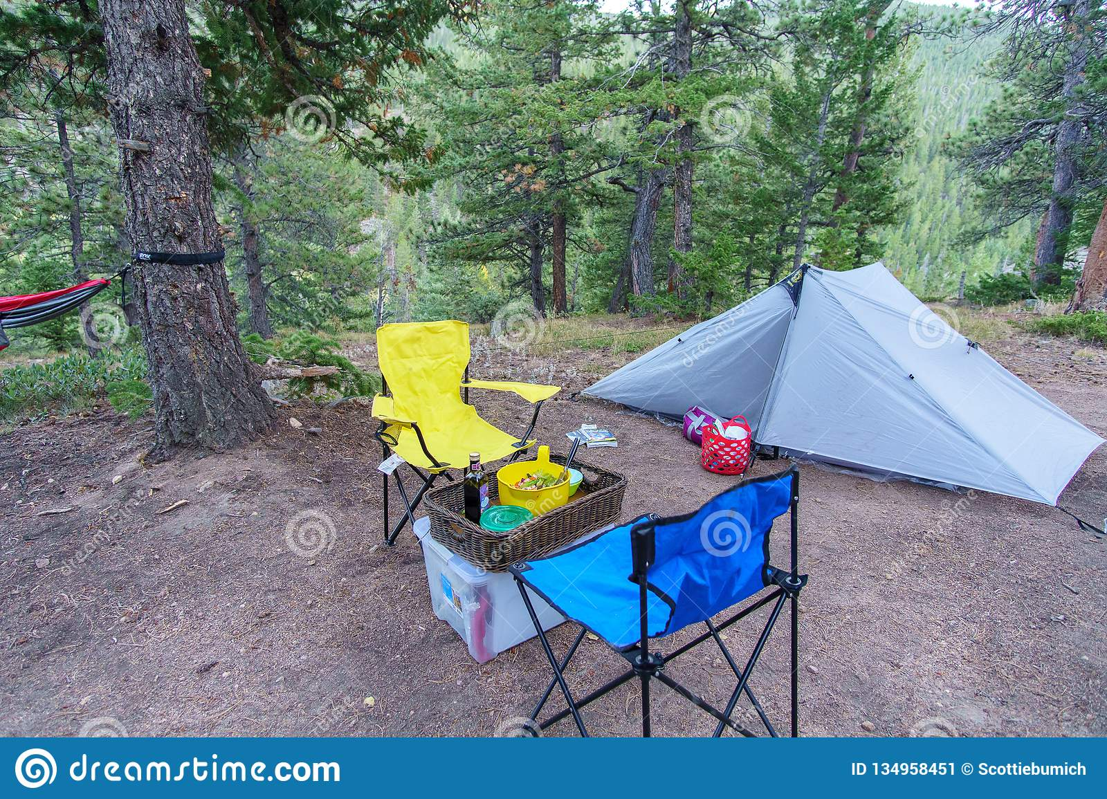 Campsite With Tent Hammock Chairs And Dinner All Ready