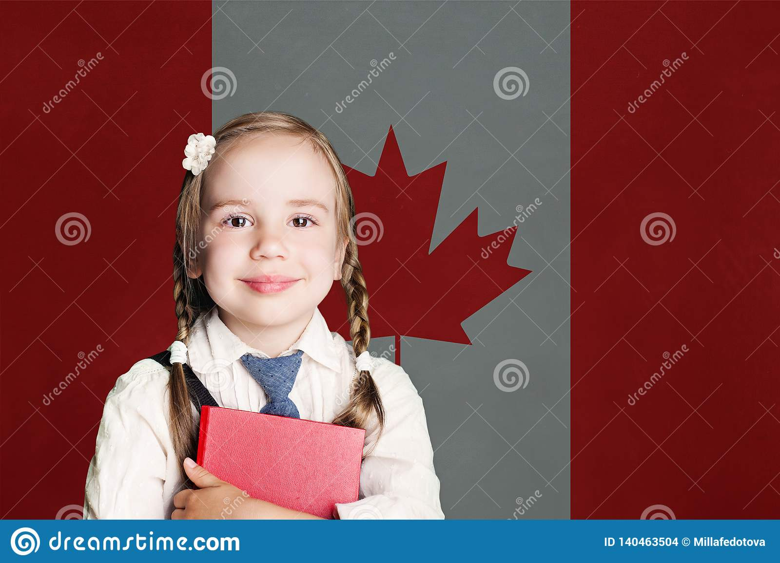 Canada concept with happy child girl in school uniform with book against the Canadian flag background