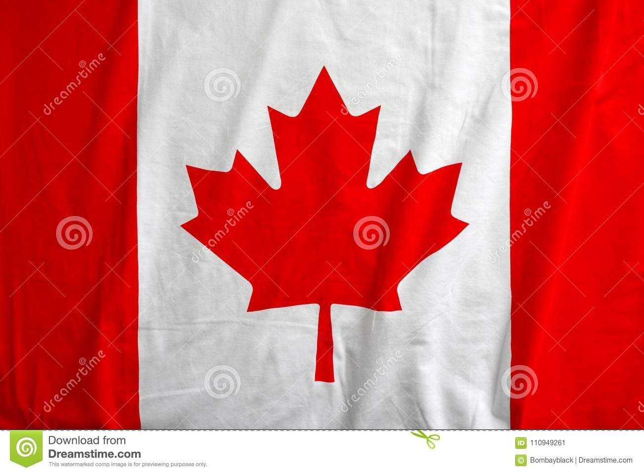 Canada flag on the fabric texture background.