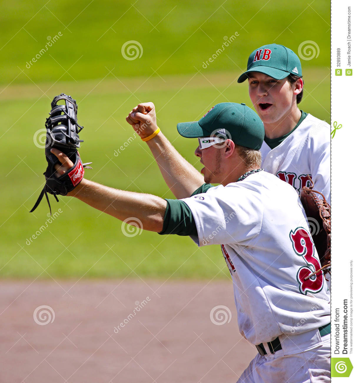 2d490c793 New Brunswick s Mitchell Hazlett (glasses) and Chris Kelly celebrate a  men s baseball win at the Canada Games August 6