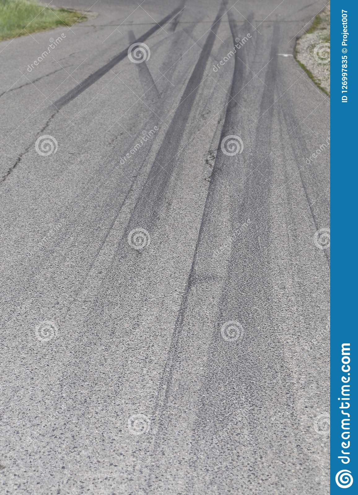 Skid marks from tire on road- police message for front cover or billboards.
