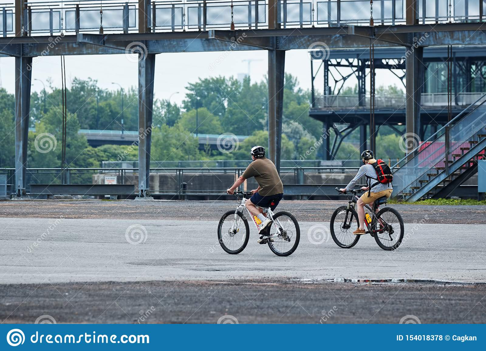 Canadian couple riding their bikes in old port, Montreal, Quebec, Canada