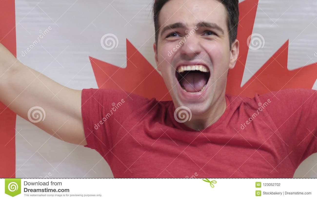 Canadian Young Man Celebrates holding the Flag of Canada in Slow Motion