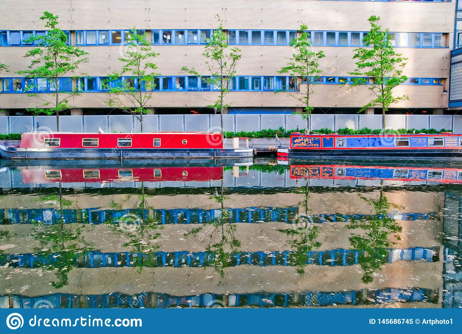 Canal boats, trees and building