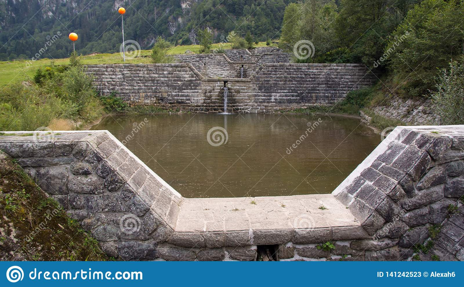 Canal of water barriers small pond on alps