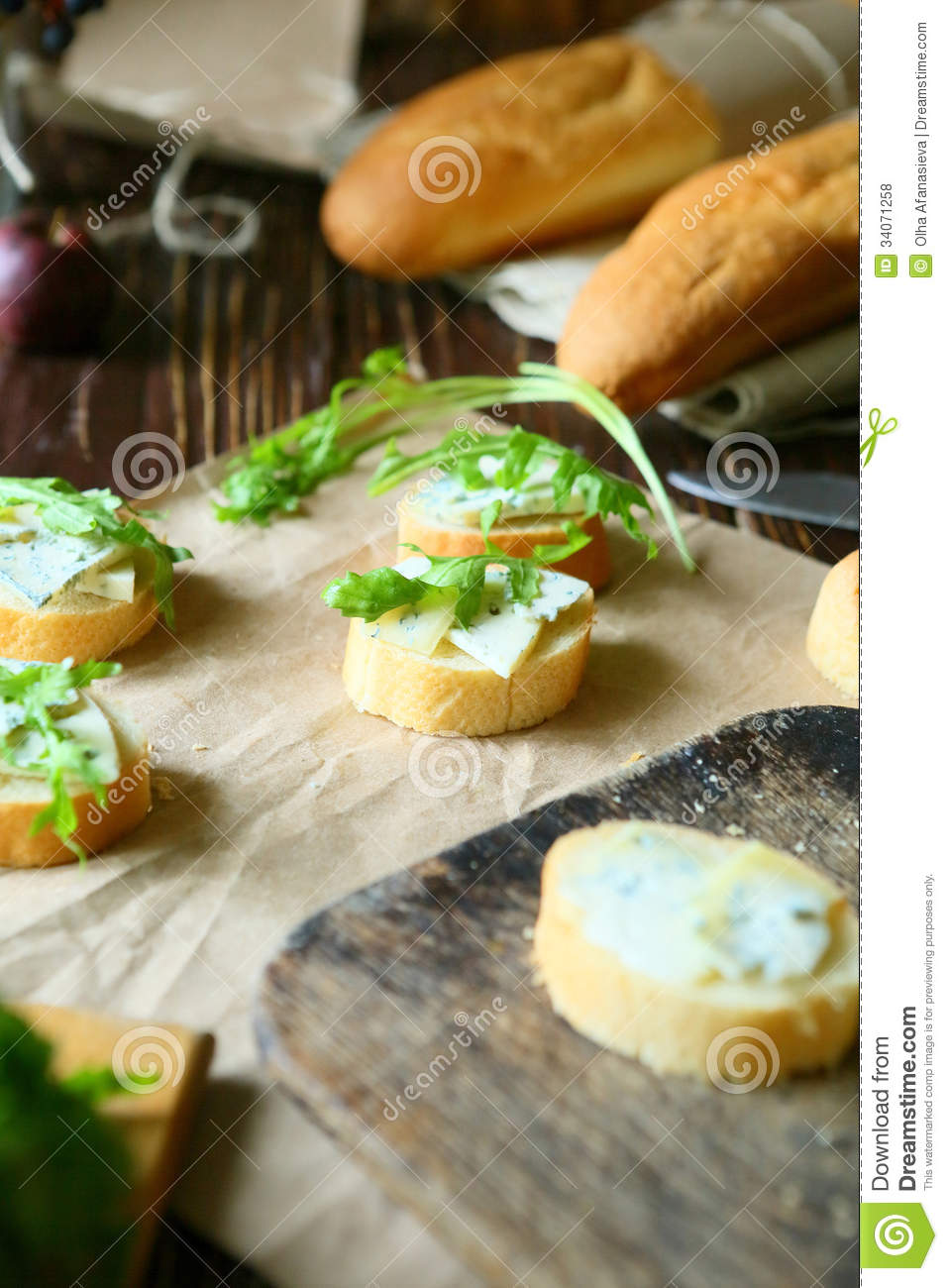 Canape with blue cheese and fresh arugula royalty free for Blue cheese canape
