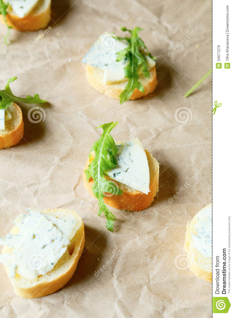 Canape with blue cheese and fresh rocket royalty free for Blue cheese canape