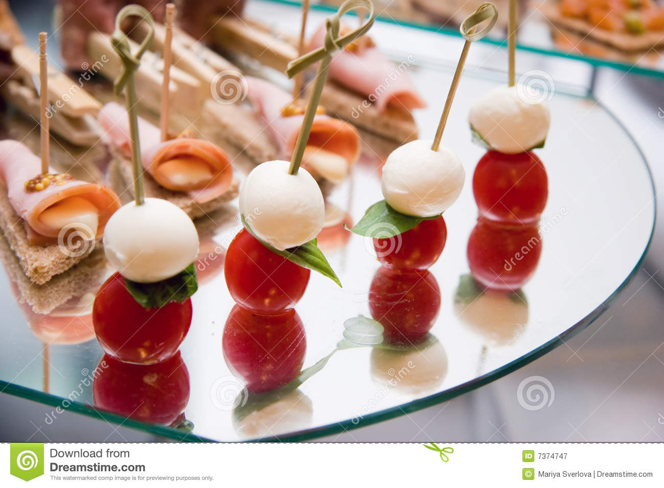 canape with mozzarella tomatoes ham and tostes royalty