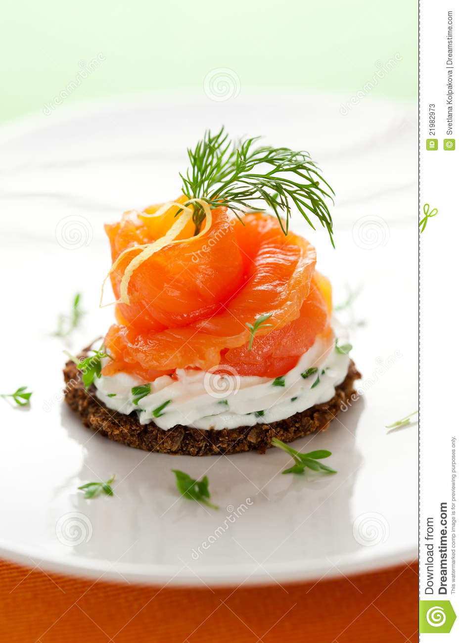 Canape with smoked salmon stock photos image 21982973 for Smoked salmon cream cheese canape