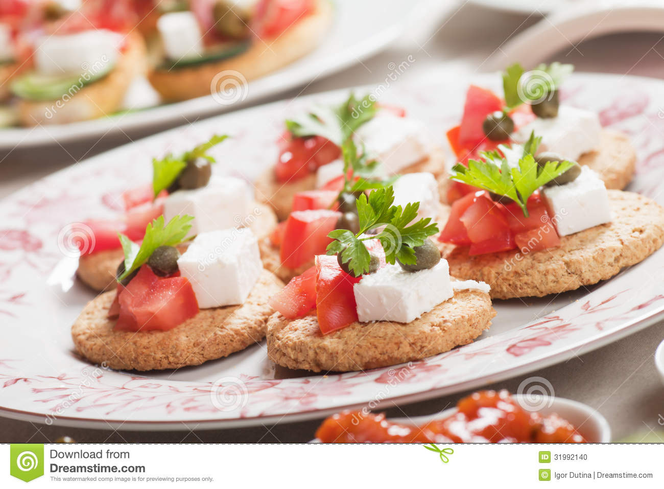 Canape with tomato and feta cheese stock photo image for Canape with cheese