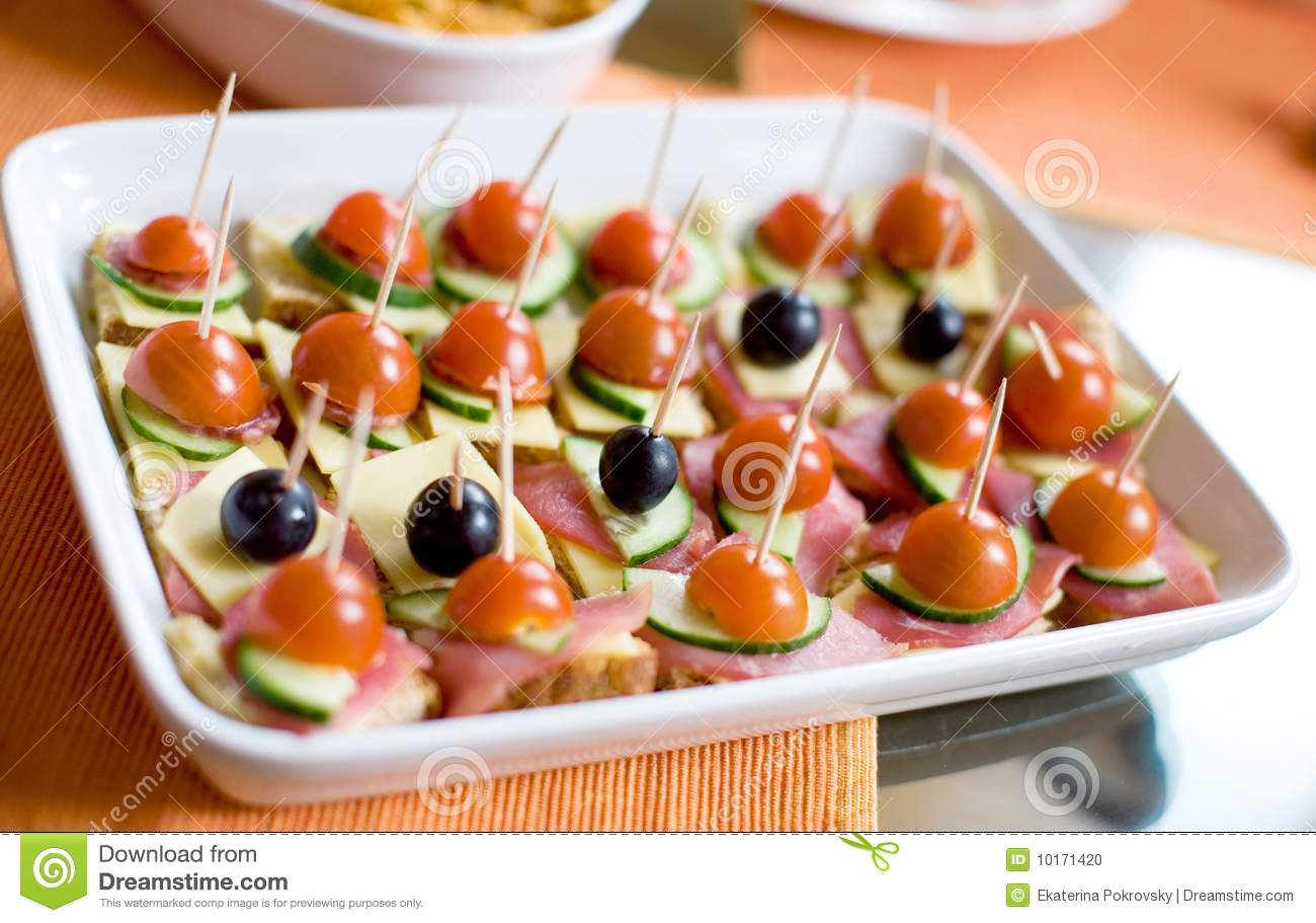 Canapes With Ham Cheese Tomatos And Olives Stock Photo