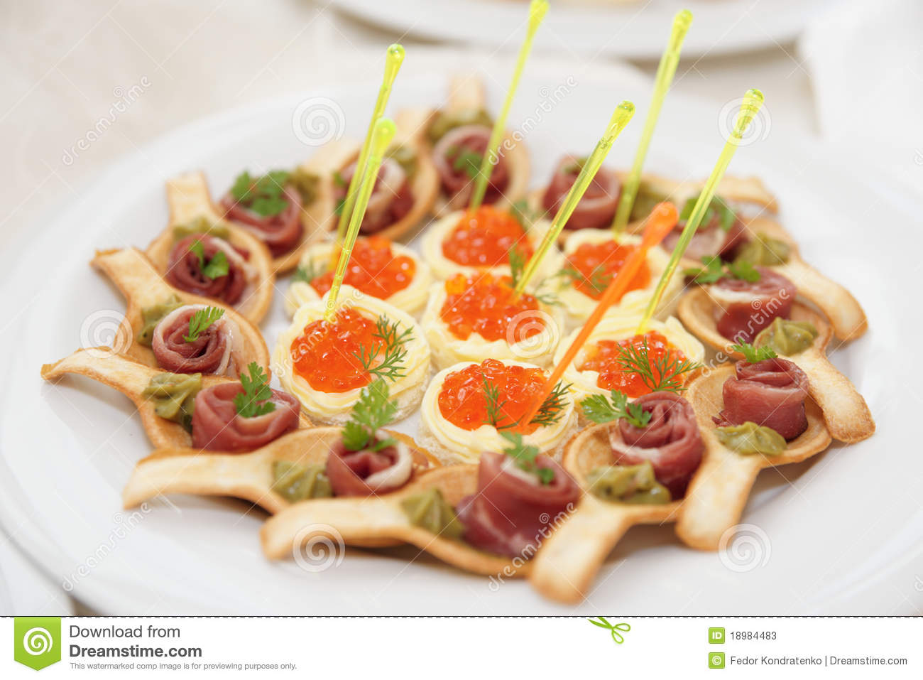 Canapes with ham and salmon caviar tartlets stock photos for Canape with caviar