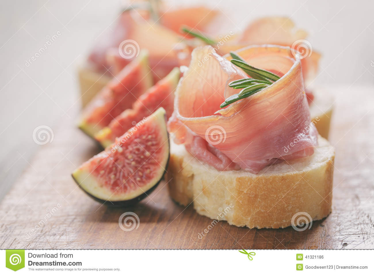 canapes with jamon and figs on table stock photo image. Black Bedroom Furniture Sets. Home Design Ideas