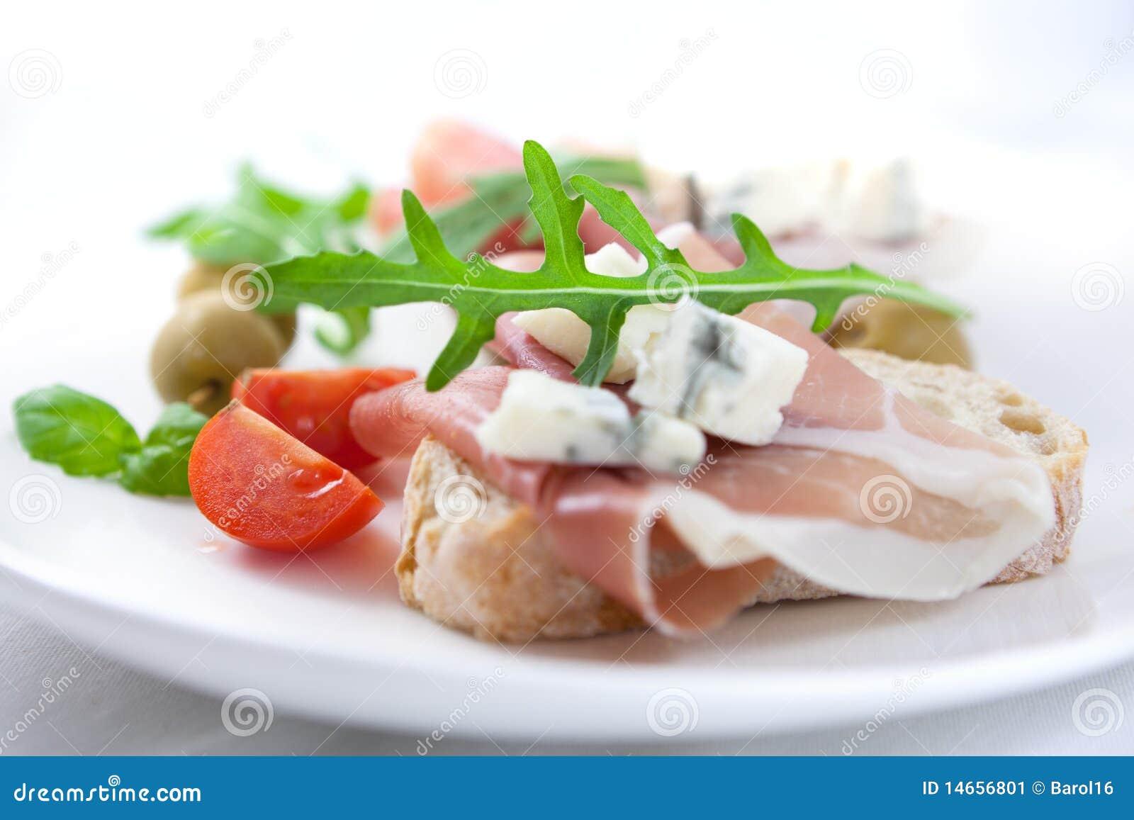 Canapes with prosciutto crudo and gorgonzola stock image for Prosciutto canape