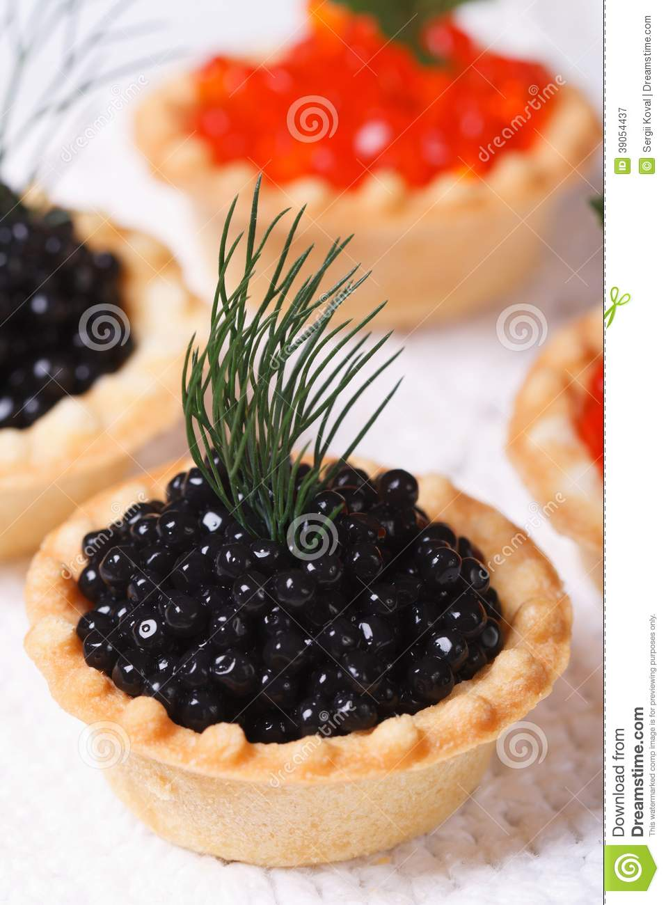 Canapes with red and black fish caviar vertical stock for Canape with caviar