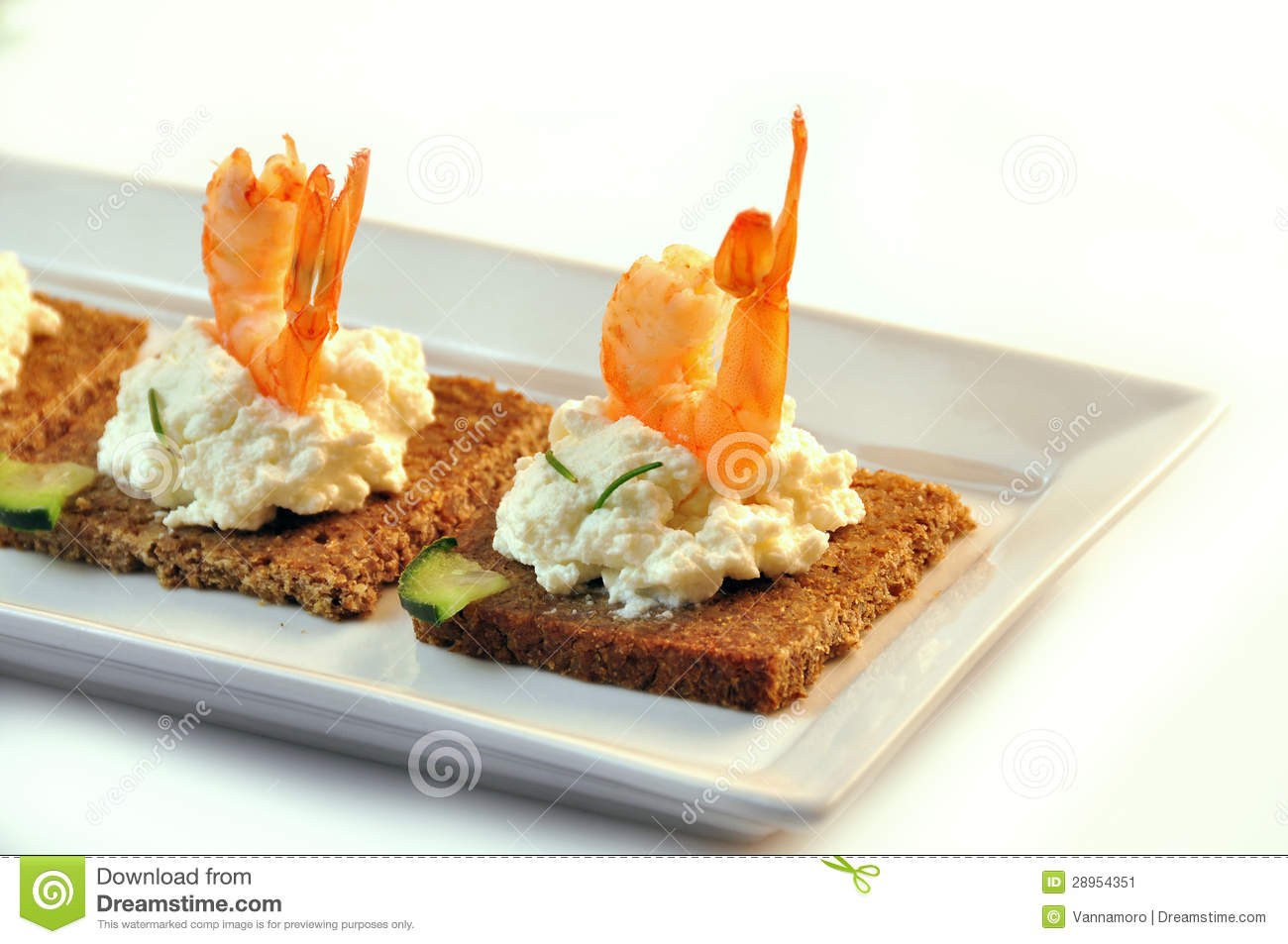 Canapes rye bread with ricotta cheese and tails of shrimps for Canape with cheese