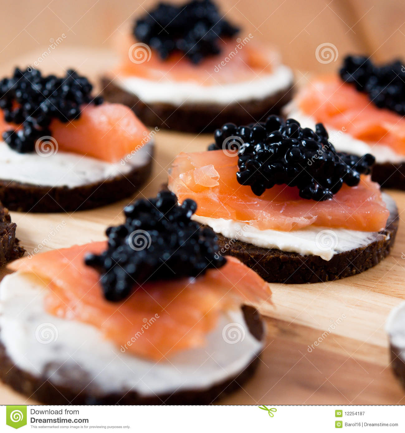 Canapes with salmon and caviar