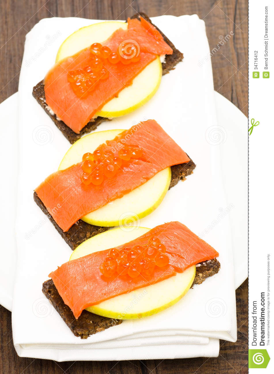 Canapes with salmon caviar and apple stock photo image for Canape with caviar