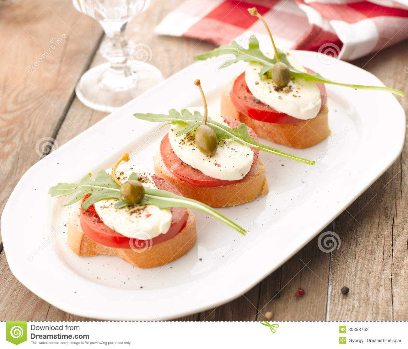Canapes with tomatoes and mozzarella stock photography for Mozzarella canape