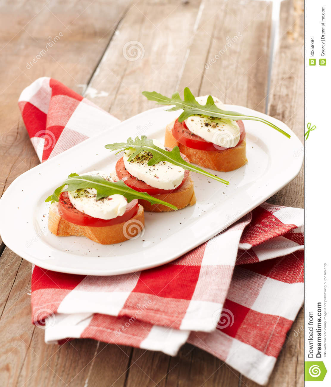 Canapes with tomatoes and mozzarella stock images image for Mozzarella canape