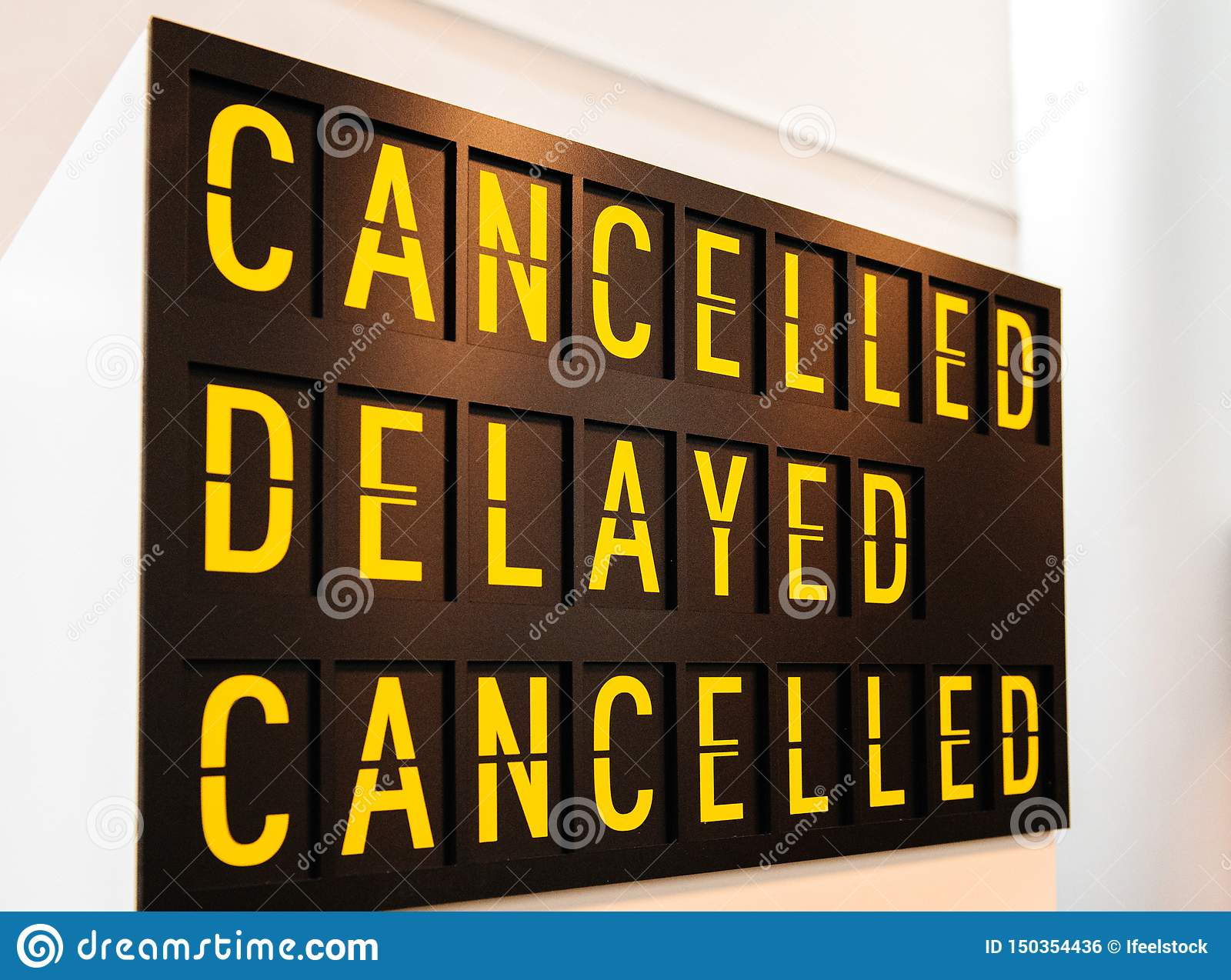 Canceled, delayed, canceled sign text letters words timetable