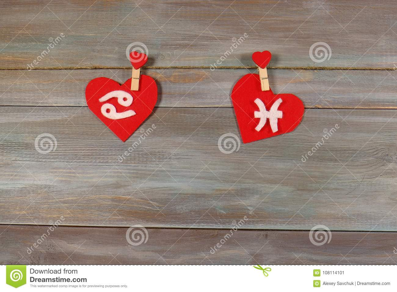 Cancer and fish. signs of the zodiac and heart. wooden backgroun