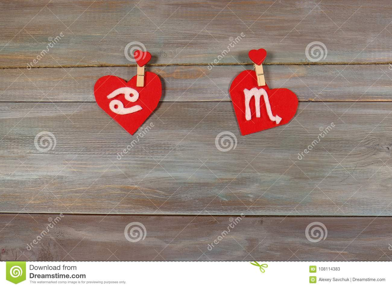 Cancer and scorpion. signs of the zodiac and heart. wooden backg