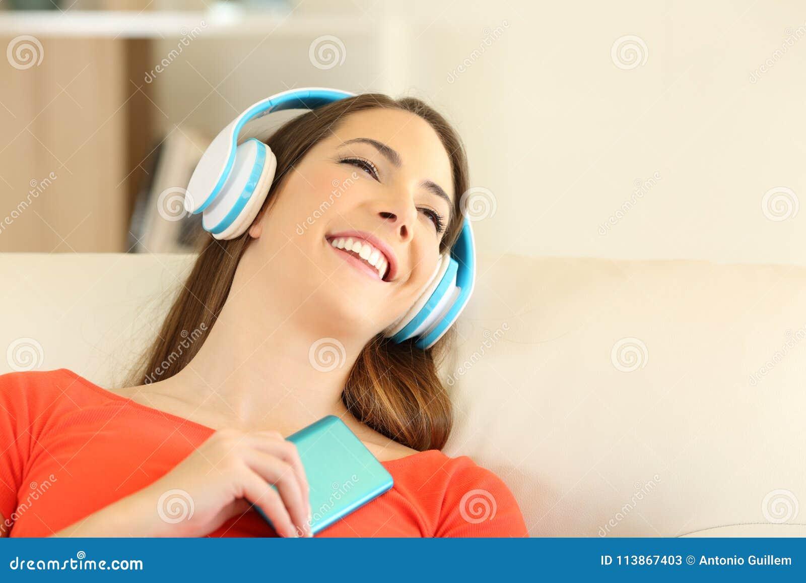 Candid Girl Wearing Headphones Listening To Music Stock Image