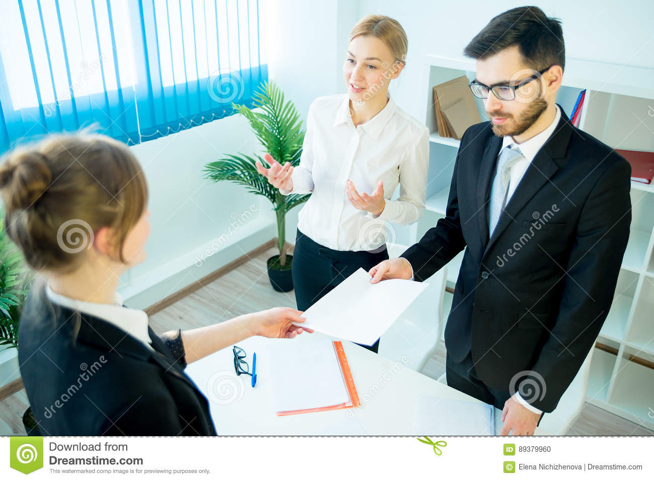 candidate handing over a resume stock photo image 89379960