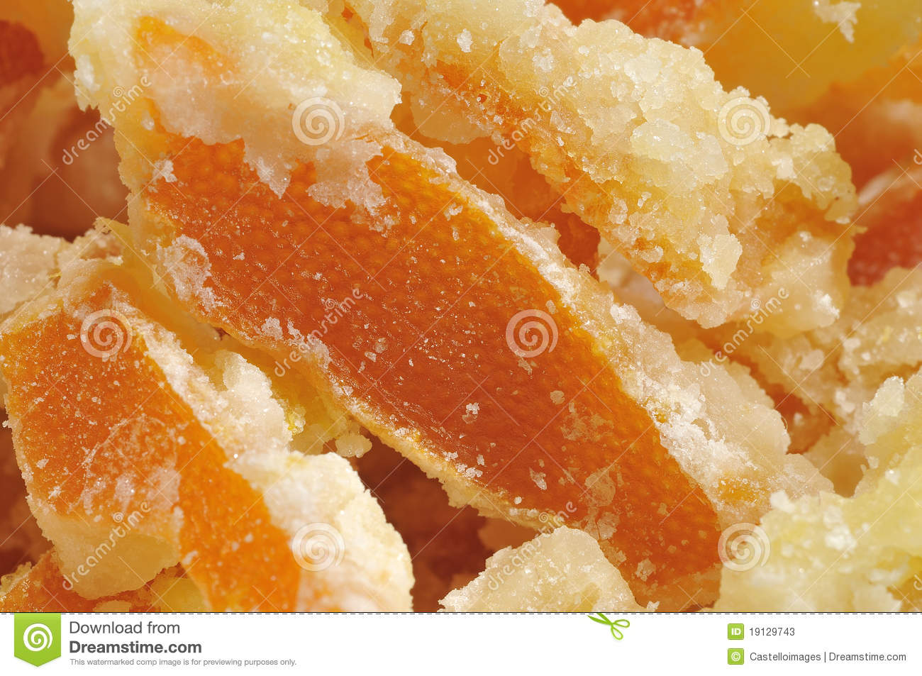 Homemade candied orange peel pieces with crystalline sugar.