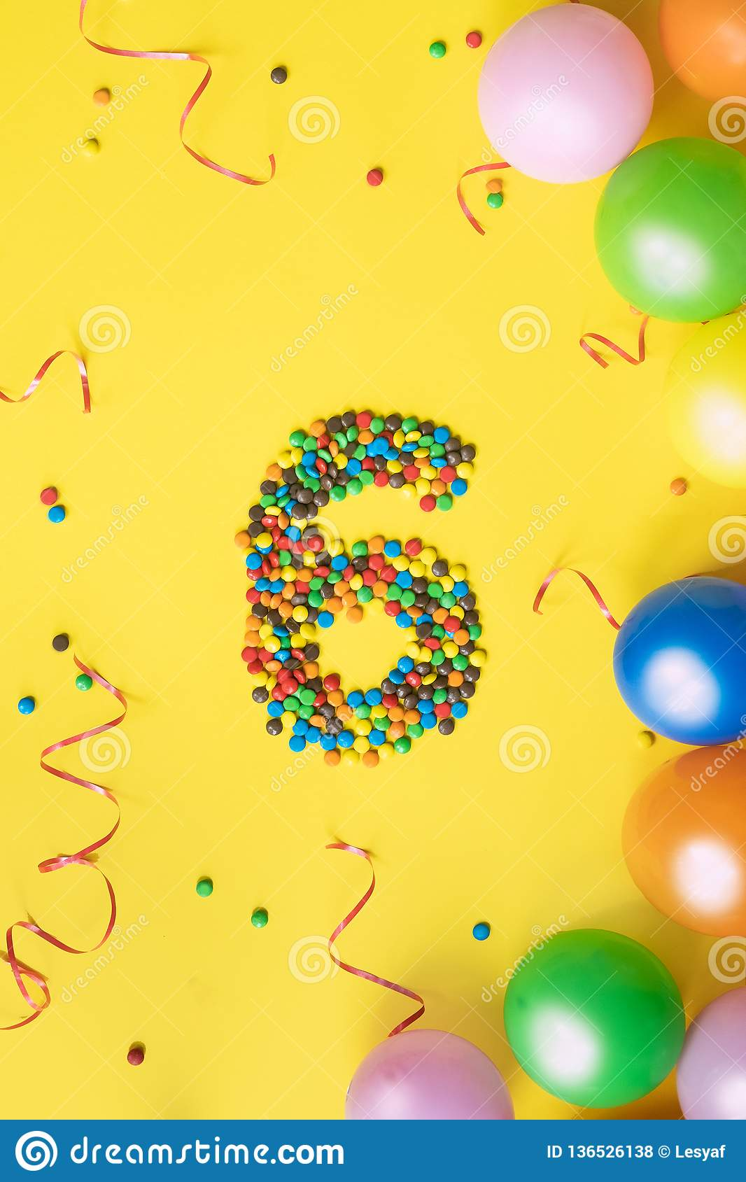 Candies Number 6 With Colorful Balloons On Yellow Background Concept For Birthdays
