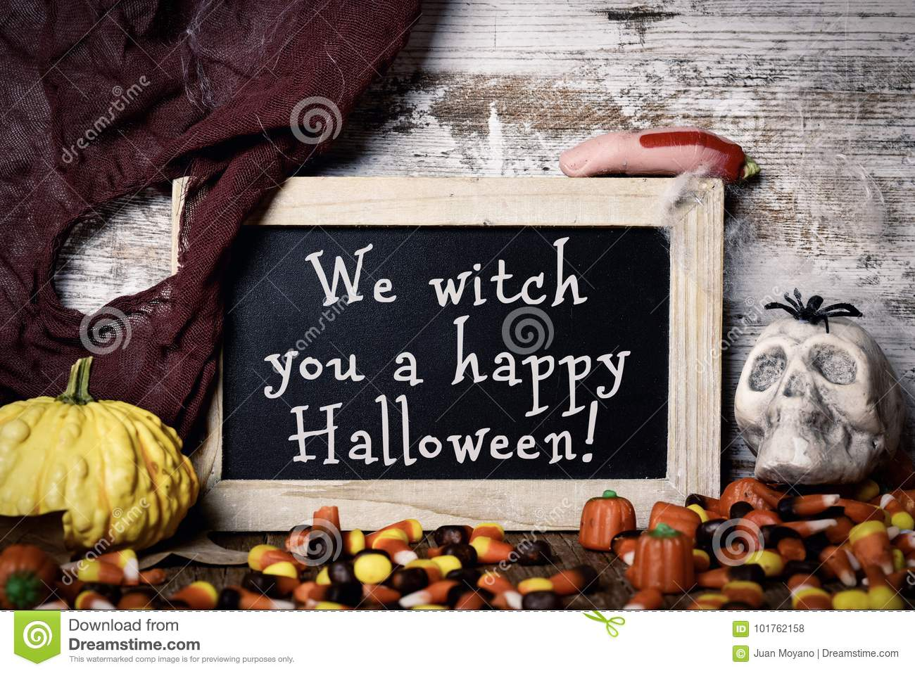 Candies and text We witch you a happy Halloween