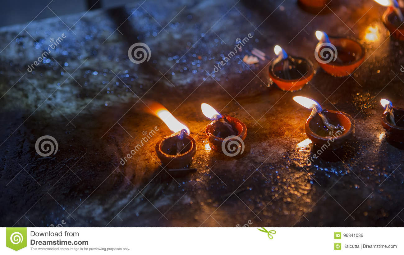 Candle flame close-up in the Indian Temple on a Religious Festival Diwali. Oil Lamp