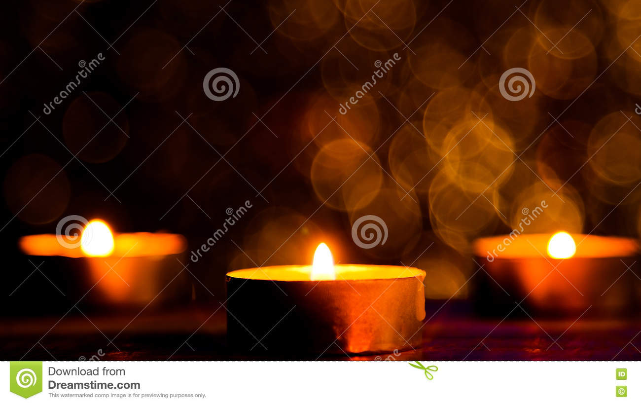 download candle flame light at night with abstract circular bokeh background christmas lights stock image