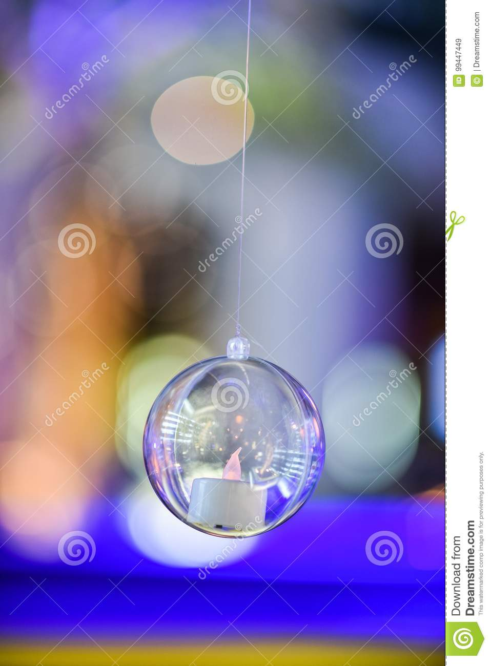 Candle In Hanging Glass Ball For Decoration Stock Image
