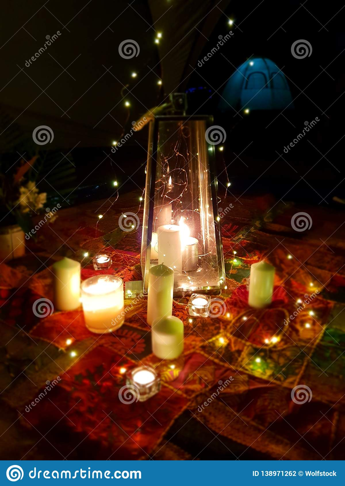 Candle lit candlelit camping picnic blanket under moonlight