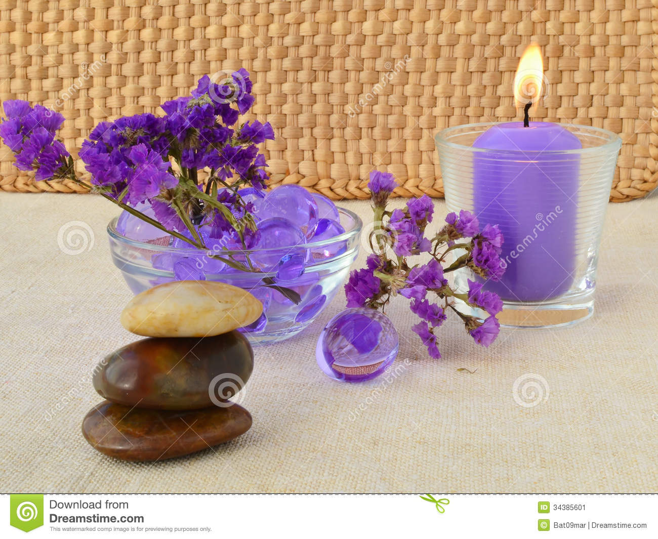 Candle And Purple Flowers Stock Image - Image: 34385601