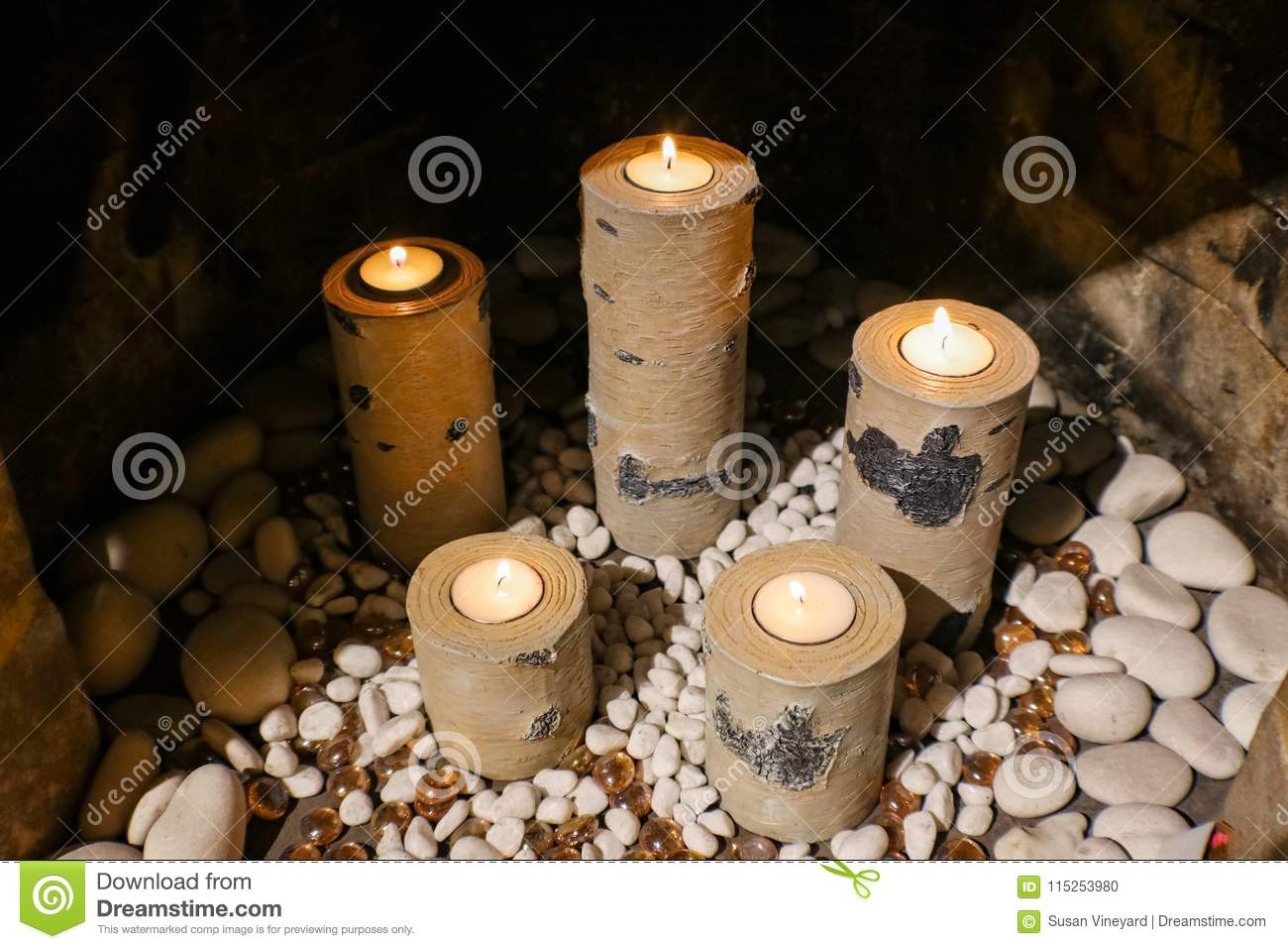 Candleholders That Look Like Birch Logs Holding Replaceable