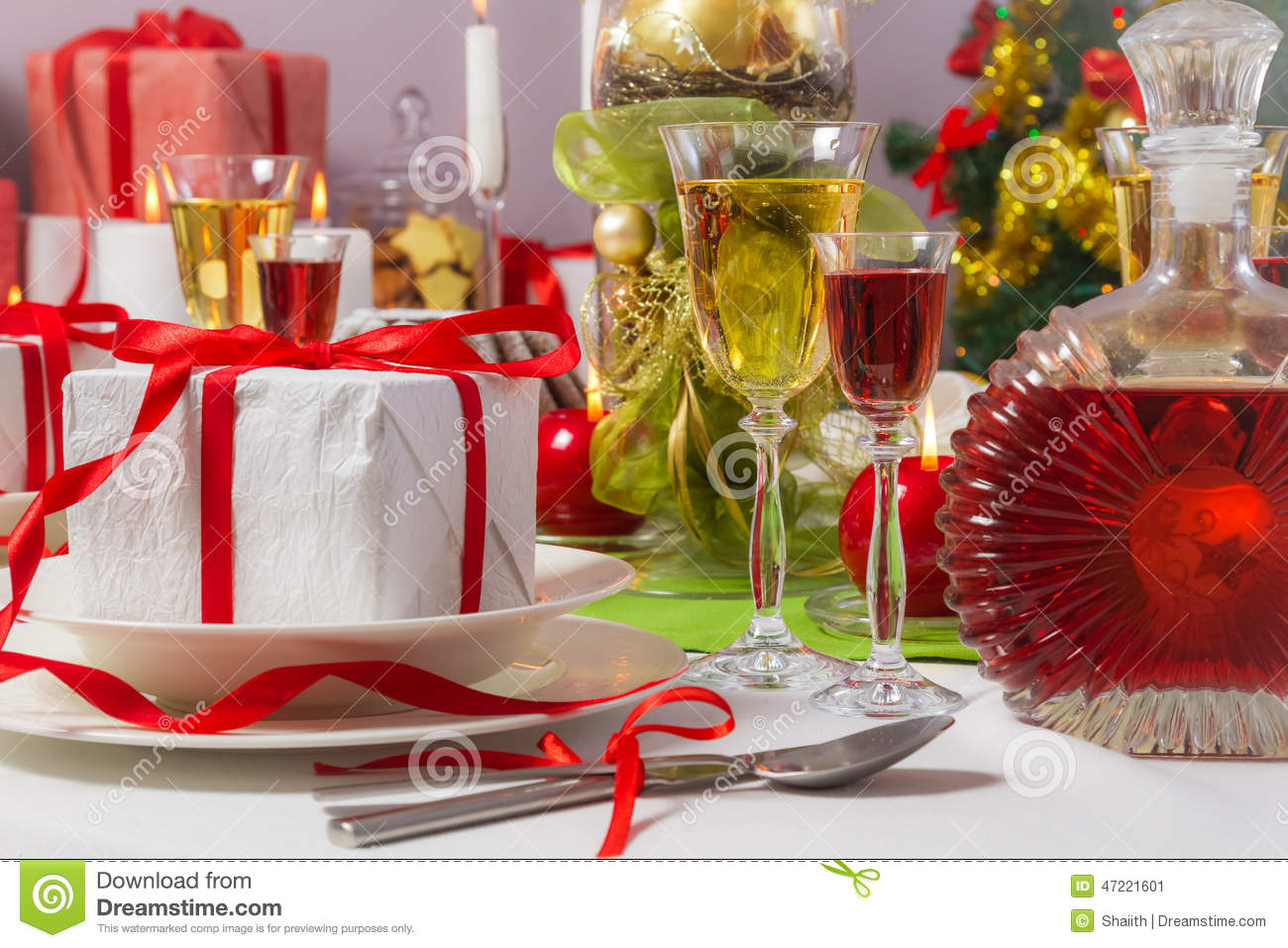 Candlelight and gifts all around the christmas table stock - Table gifts for christmas ...