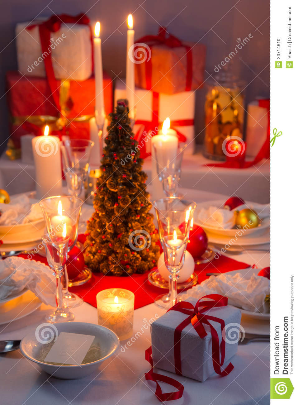 Candlelight wafer and gifts on the christmas table stock - Table gifts for christmas ...