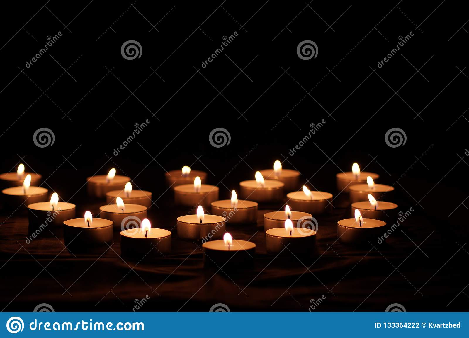 Burning candles with bright flames
