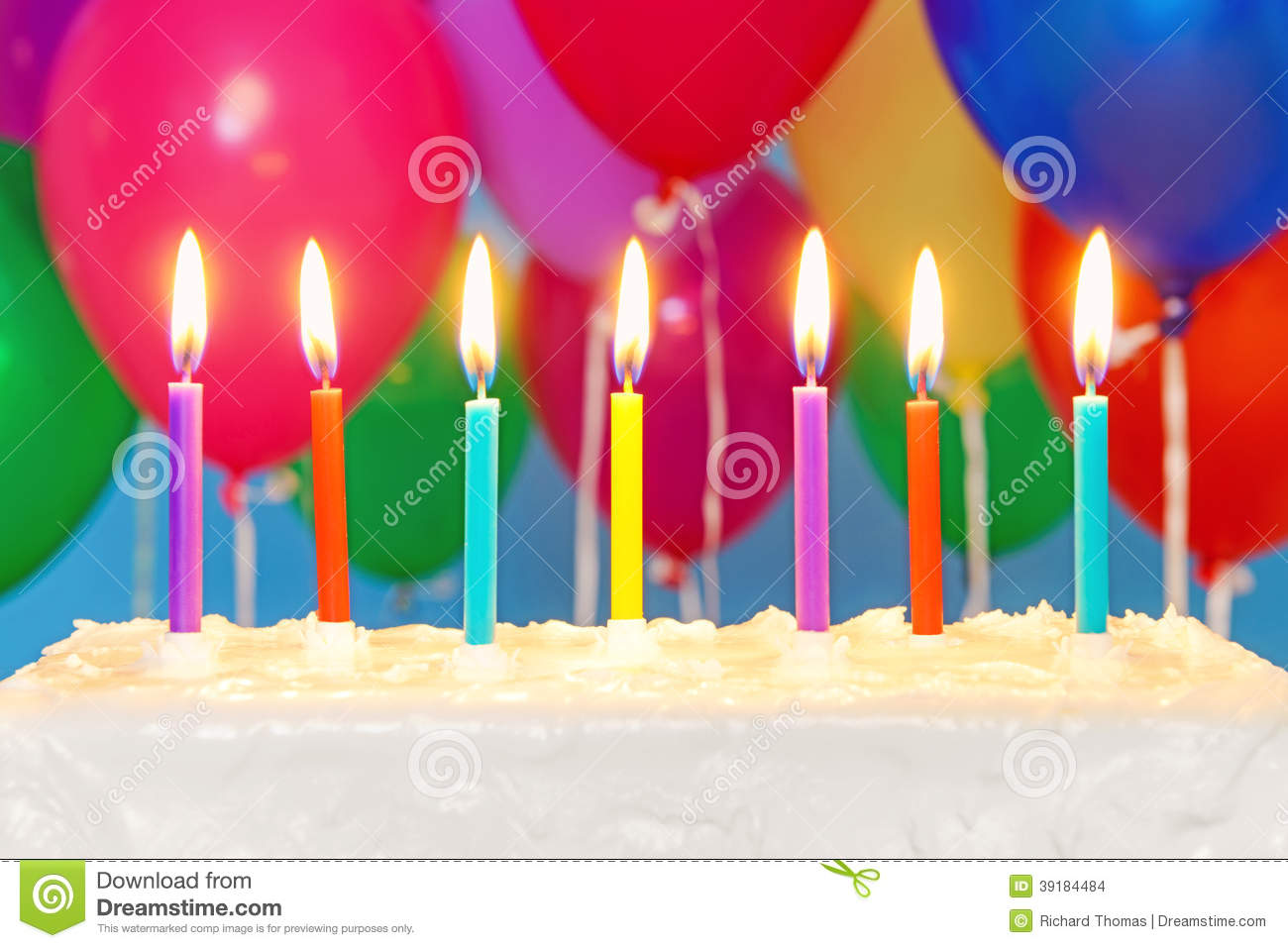 Happy birthday lit candles on colorful balloons royalty free stock - Candles On A Cake With Balloons In Background Stock Photo