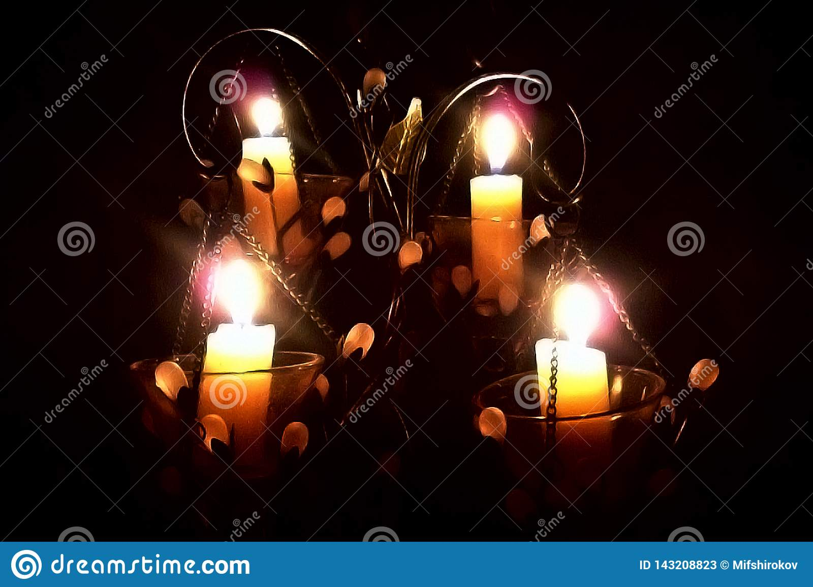 Candles in a candlestick on a black background