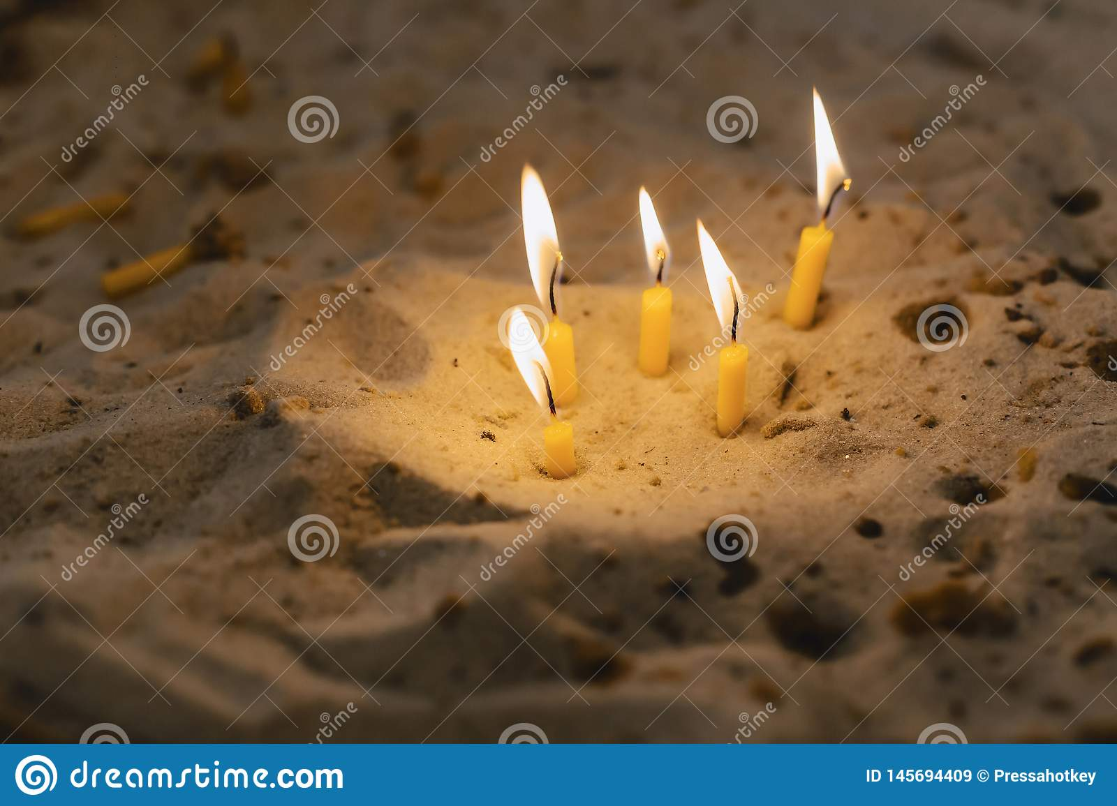 Candles in the church in the sand