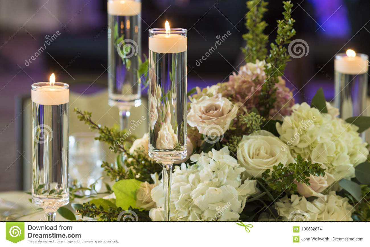 Candles Floating In Stemware And Roses For Wedding Reception Stock