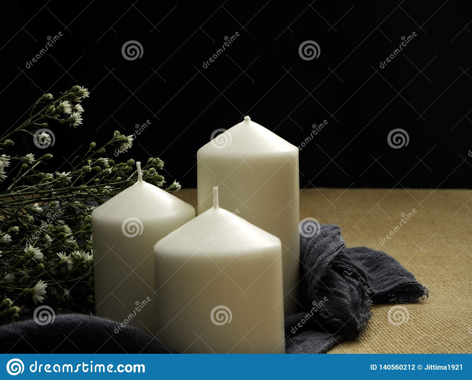 candles and flowers on table